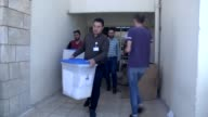 Election committee workers place ballot boxes at a polling station ahead of the upcoming referendum for independence of Kurdish regional government...