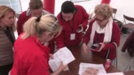 Election officials start counting ballots cast by Turkish expats at Ankara Chamber of Commerce headquarters after the voting for the constitutional...