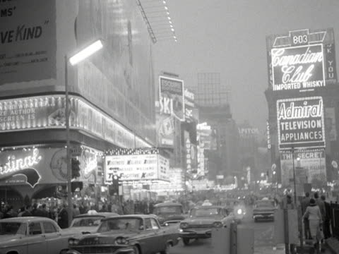 Electric billboards advertise cinemas and shops on Times Square in New York