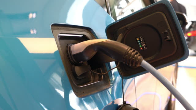 Electric Car Charging a power at power station