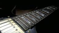 Electric Guitar On Black Background. Tracking Shot