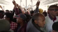 Electric light railway tracks soar over Ethiopia's capital Addis Ababa a rare example of mass transit infrastructure on a continent ruled by...