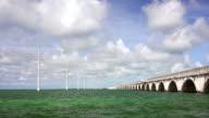 Electric power lines in ocean run along Seven Mile Bridge in the Florida Keys