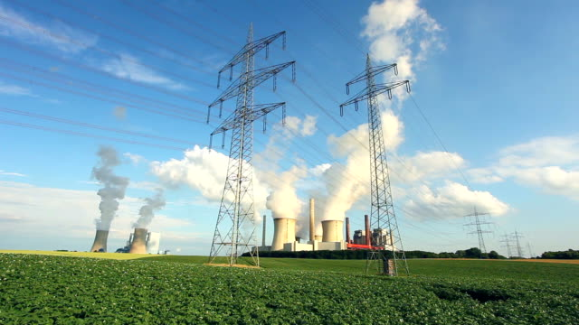 Electric pylons in front of two coal power stations