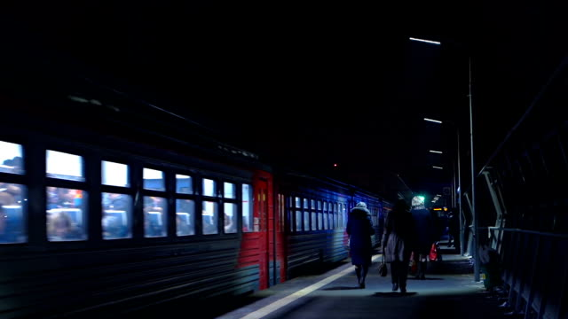 Electric train and railway station at night