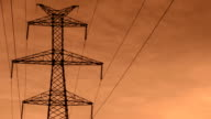 Electrical Pylons zoom out at sunrise HD Time Lapse Video