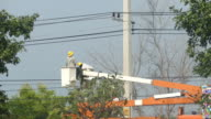 Electrician with boom truck and basket