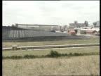 Electricity / British Coal joint venture ENGLAND Nottinghamshire Bilsthorpe Colliery GV Coal stock heap in yard as bulldozer at work on top Bulldozer...