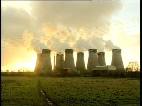 Electricity pylons and power stations pumping out steam UK