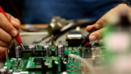 Electronic Engineer checking circuit board