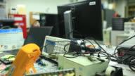 Electronic Engineer checking circuit board