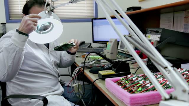 Electronics laboratory, checking circuit board