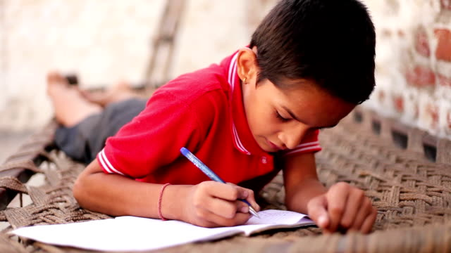 Elementary age student studying at home