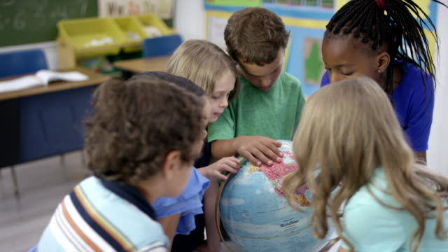 Elementary first graders learning geography