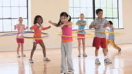 WS PAN Elementary School children hula hooping in gym / Richmond, Virginia, United States