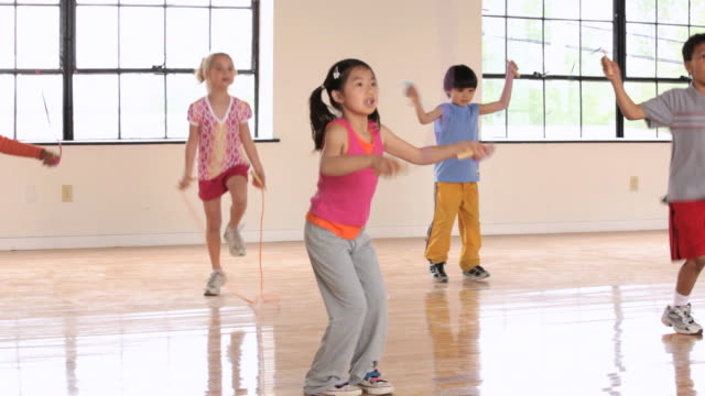 WS PAN Elementary School children jumping rope in gym / Richmond, Virginia, United States