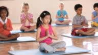 MS PAN Elementary School children practicing yoga, meditation in gym / Richmond, Virginia, United States