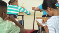Elementary School Students Taking a Test