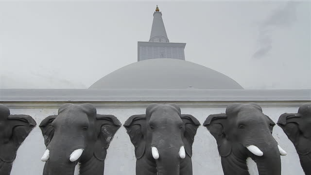 MS Elephant statues guard Ruwanwelisaya Dagoba or Stupa / Anuradhapura, North Central Province, Sri Lanka