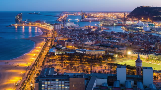 Elevated dusk view over Barcelona beaches and seaport, Barcelona, Catalunya, Spain - Time lapse