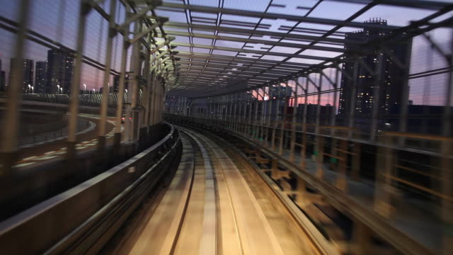 WS POV Elevated train moving through tunnel at dusk / Tokyo, Japan