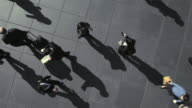 Elevated view of businesspeople walking, time lapse