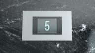 LD Elevator indicator showing floor numbers going down