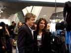 Arrivals / interviews Edward Speleers and Gabriella Cilmi posing for photocall / Speleers and Cilmi drinking champagne