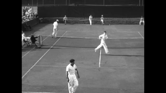 Ellsworth Vines of US and Americo Cattaruzza of Argentina playing tennis point goes to Vines / Vines serving and returning / playing point goes to...