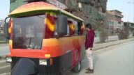 Emblazoned with a giant hot dog and an Afghan flag the food trucks serving Western fast foods are slowly winning over the hearts and stomachs of the...