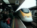 Emergency drill ENGLAND Kent Ashford LMS Eurostar train along into crowded platform towards and past INT GV Crowded waiting room PAN CMS Screen...
