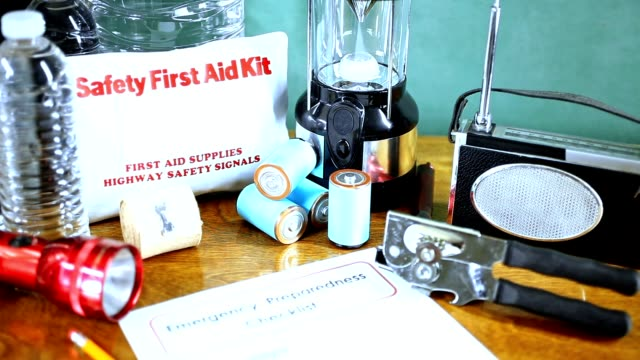 Emergency preparedness natural disaster supplies.  Water, flashlight, lantern, radio, batteries, first aid kit.