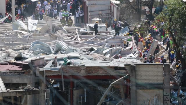 Emergency responders work at the scene following an explosion at a childrens and maternity hospital in the Cuajimalpa borough in the western part of...