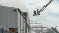 Emergency services at the scene of fire at the Air Livery hanger at Southend Airport in Essex