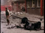 Emergency services start to clear up the debris following a car bomb explosion on Adelaide Street in Belfast