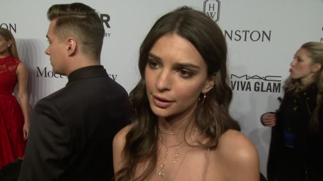 INTERVIEW Emily Ratajkowski on how she likes supporting amfAR and is looking forward to the Gala at amfAR to Honor Harvey Weinstein at Annual New...
