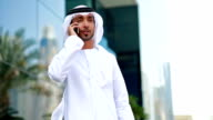 Emirati businessman talking on the phone