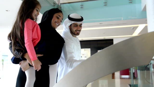 Emirati family using information display