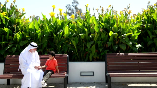 Emirati grandfather and grandson at the park
