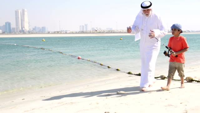 Emirati grandfather and little boy going fishing
