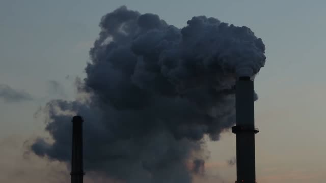 Emissions rise from Northern Indiana Public Service Companys NIPSCO Bailly Generating Station on the shore of Lake Michigan in Chesterton Indiana US...