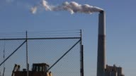 Emissions rise from smokestacks as electricity is generated at the coalfired Kentucky Utilities Company Ghent Generating Station in Ghent Kentucky US...