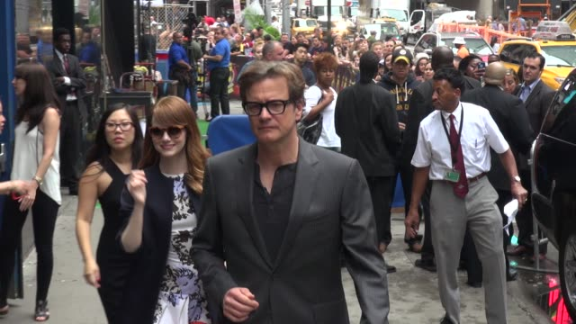 Emma Stone and Colin Firth exits the Good Morning America show and greets fans before leaving Celebrity Sightings in New York on July 16 2014 in New...