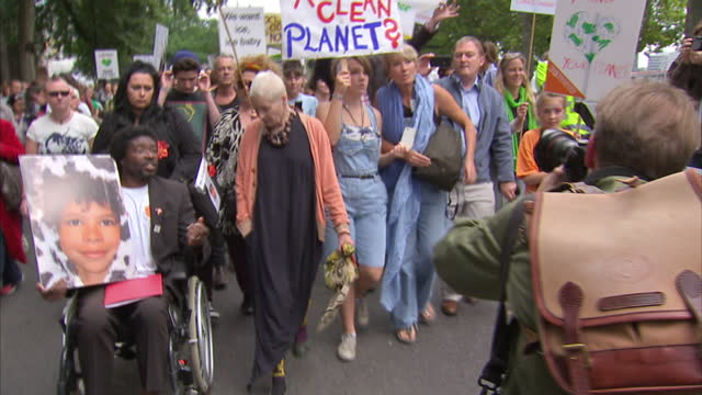 Emma Thompson her daughter Gaia Romilly Wise march during climate change protest on September 21 2014 in London England
