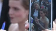 Emma Watson greets fans at the This Is The End Premiere in Westwood 06/03/13