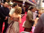 Emma Watson standing on red carpet Radio City Music Hall BG talking to various press