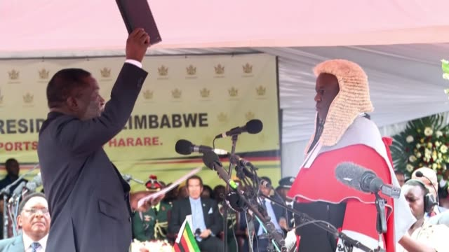 Emmerson Mnangagwa sworn in as president ZIMBABWE Harare EXT Emmerson Mnangagwa waving to cheering crowds in sports stadium as walking to podium at...
