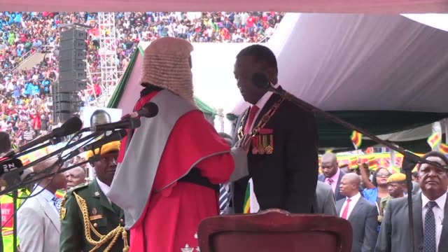 Emmerson Mnangagwa whose removal as vice president by Robert Mugabe led to the veteran leader's ouster is sworn in as Zimbabwe's new president
