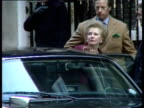 Emotional Margaret Thatcher waves to supporters and is helped into car by son Mark before leaving for Buckingham Palace to deliver her resignation as...