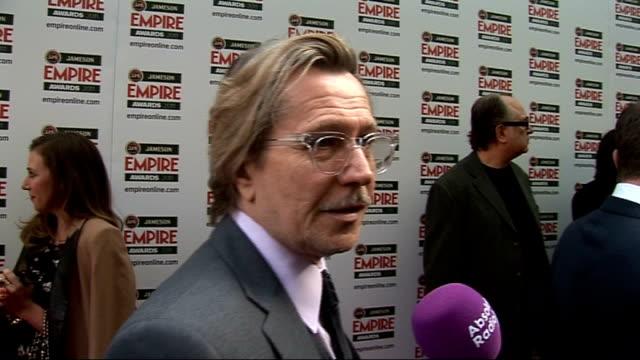 celebrity arrivals / winner's room interviews Oldman speaking to press not heard / Olivia Williams speaking to press Gary Oldman interview SOT On...